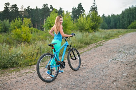 Sport woman with bike enjoy summer vacation, active lifestyle.
