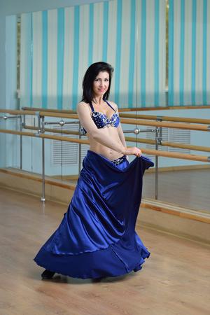 bellydancing: Beautiful woman in arabic costume posing, oriental or belly dance.