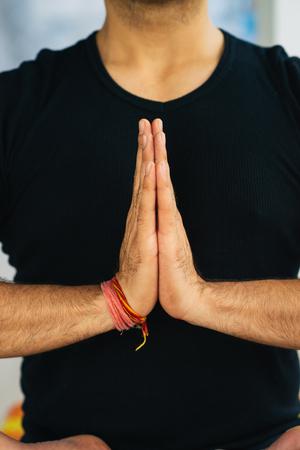 samadhi: Hands in Namaste prayer mudra by Indian man practicing yoga