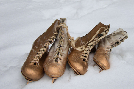 Vintage ice skates for figure skating lying on the snow