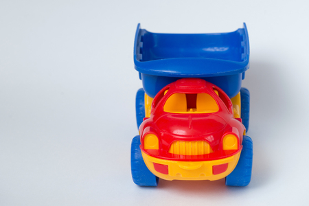 plastic childrens toy car, front view, copy space is available