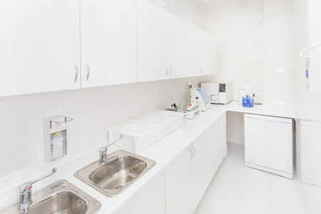 Dental sterilization department interior, Modern laboratory washing, cleaning and sterilizing machines. Standard-Bild