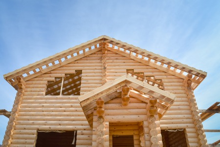 Structure of a new wooden house under construction on blue sky background Stock Photo - 86265813