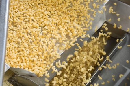 Industrial production of pasta on automated food factory