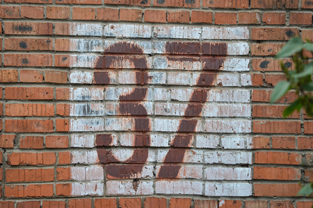 Old home number, 37, at the brick wall. Thirty seven. Stock Photo