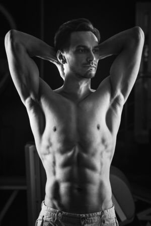 A Strong Muscular man with torso abs. Black and white.