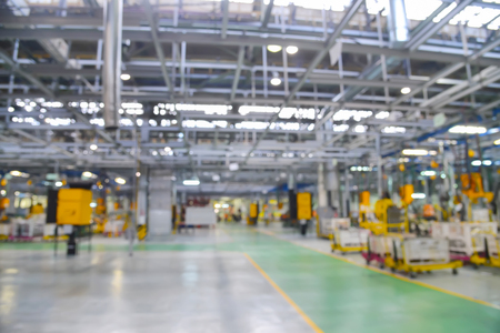 Blurred or defocused modern manufacturing factory background, Industrial space