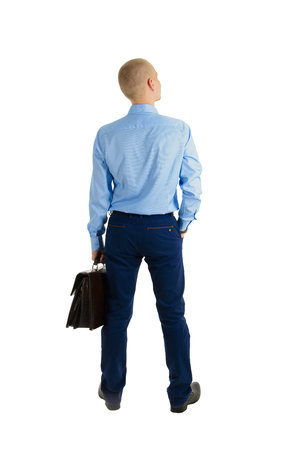 Portrait of caucasian businessman with briefcase standing back and looking at distance isolated on white background.