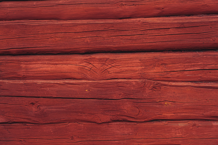 Wooden red log wall background, traditional in Scandinavia Stockfoto