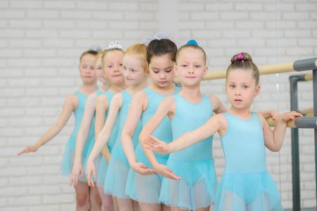 Ballet school. Little girls students practicing near barre .Middle shot of ballerinas in dance class. 版權商用圖片