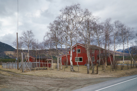 Norwegian spring landscape, Norway countryside. Classic wooden houses near mountains. 스톡 콘텐츠