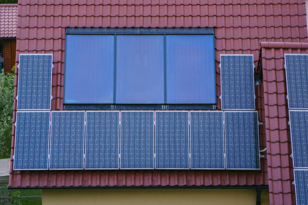 Solar panels on rood of modern resiadental house, renewable energy system.