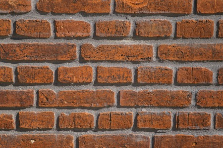 Old vintage red brick wall, grunge background