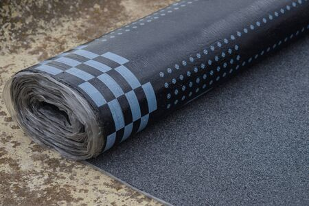 Waterproof bitumen roll covered with insulation materials. Archivio Fotografico