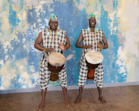 Two African musician with traditional clothes and drums