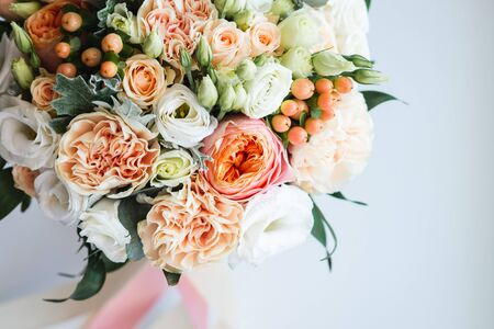 Beautiful wedding bouquet decorated with white and pink roses, bridal flowers of pastel colour 写真素材