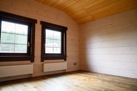 Empty room in a new wooden house, walls colored with natural paint . 写真素材