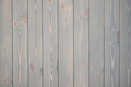 The unique texture of wooden wall made of planks colored with natural pastel paint, tiled background