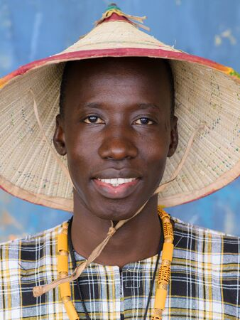 Handsome African man in traditional costume, closeup portrait