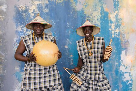 Happy african drummers playing music on blue background Stock fotó