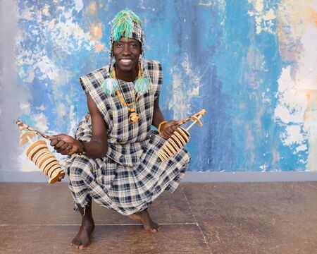 African musician with traditional clothes and musical instruments 写真素材