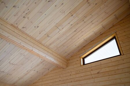 Interrior of new wooden house, walls and roof colored with natural paint .