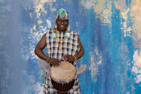 Portrait of handsome african musician with Djembe drum