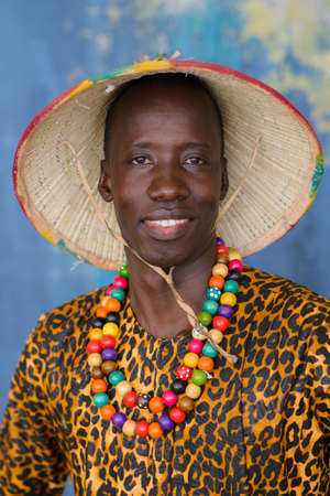 Closeup portrait of handsome african man in traditional Fulani hat and colorful clothes