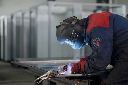 Welder working on factory, Welding Work. Erecting Technical Steel Industrial Craftsman on plant