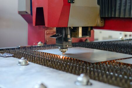 Industrial fiber laser cutter. Plasma cutting of metal. Sparks flying from laser. Standard-Bild
