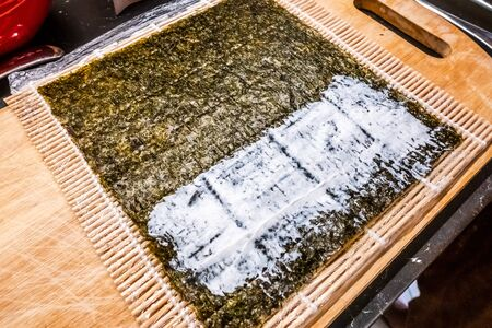 bamboo rolling mat for homemade sushi with nori and ricota