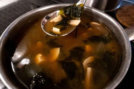 homemade miso soup with mushrooms in a pan