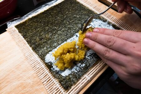 bamboo rolling mat for homemade sushi with nori, ricota and quinoa