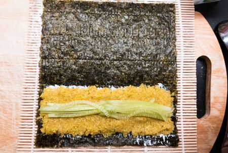 bamboo rolling mat for homemade sushi with nori, ricota, quinoa and cucumber