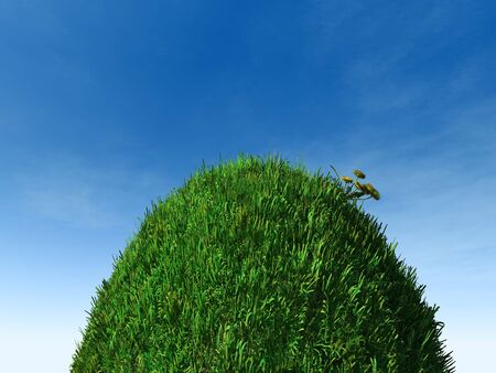 A round grass globe on a steep hill. Imagens