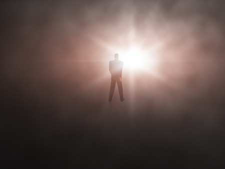flash light: Man walking from dark abyss into a bright light abstract. Stock Photo