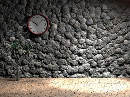 A clock on a stone wall with spot light and cracked earth with copy space. photo