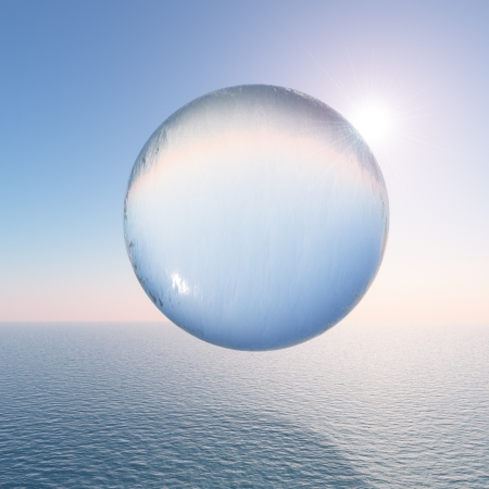 A surreal water sphere hovering above the sea against a clear sky and sun. Stock Photo