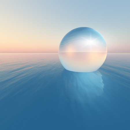 magic ball: A surreal crystal sphere floating over the ocean horizon on clear morning sky.