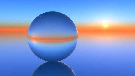 horizons: A glass orb on a horizon sunset. Stock Photo