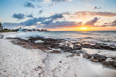 Sandy shoreline displayed at low tide in this view of the shoreline at sunset in the Bahamian island