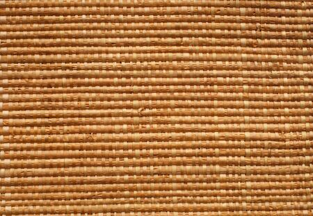 a straw: hand made straw mat - nice pattern