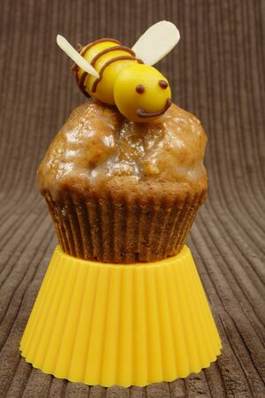 marzipan bee on a honey muffin photo