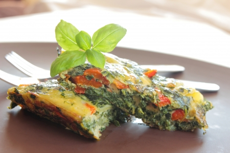 two pieces of spinach omelet Stock Photo