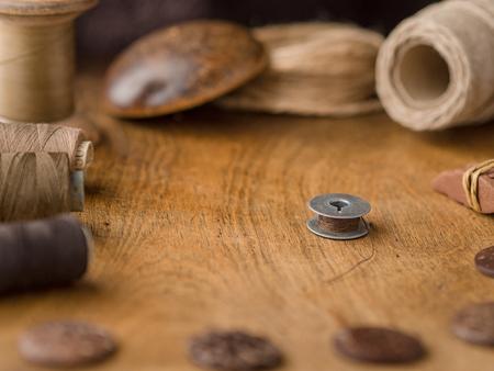 Vintage bobbin on sewing backgound
