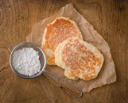 homemade pancakes with powdered sugar on wooden table Stock Photo