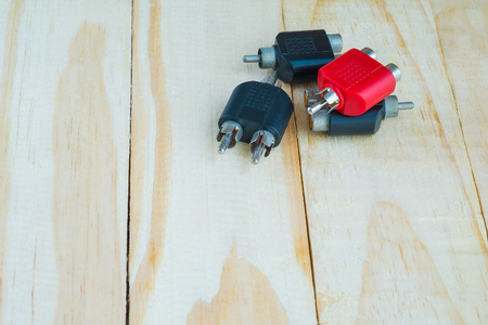rca: RCA Jack for audio system on wooden Stock Photo