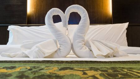 bedsheets: Towels decoration in bed room hotel., Heart is a symbol of love and romance.