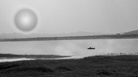 catchment: Scene of boat in river with hill , forest and sun, Black-white picture