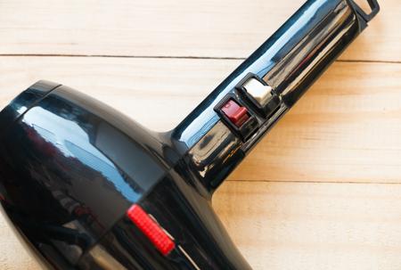 hair dryer: control switch of hair dryer, Hair dryer on wooden